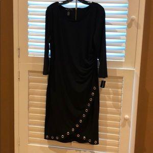 Black dress with designed gold holes